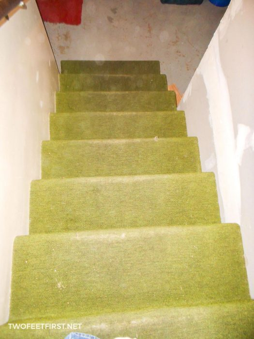 stairs with old green carpet