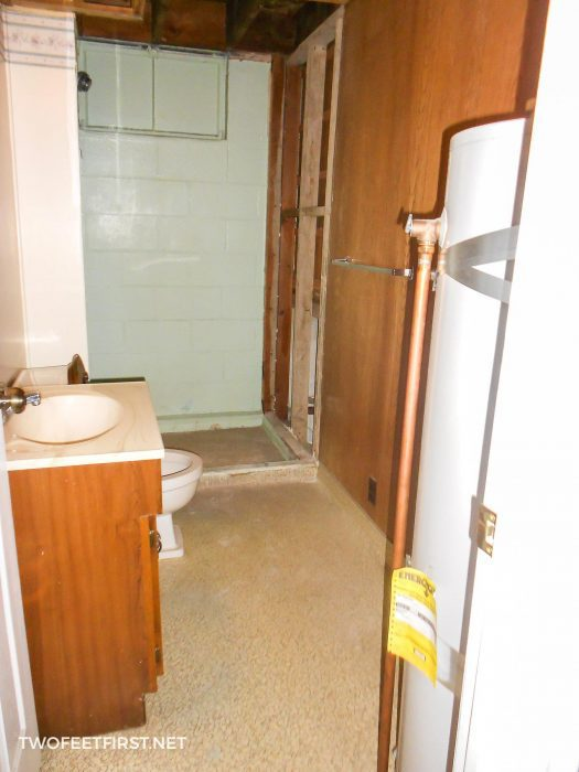 old basement bathroom with water heater