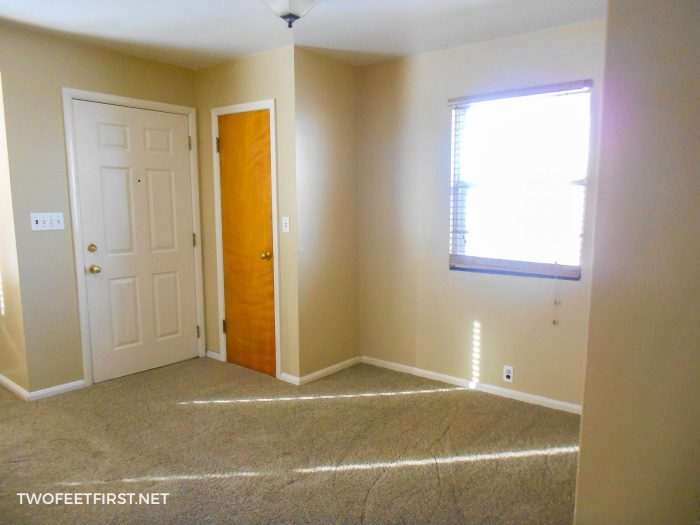 living room with brown walls before updated
