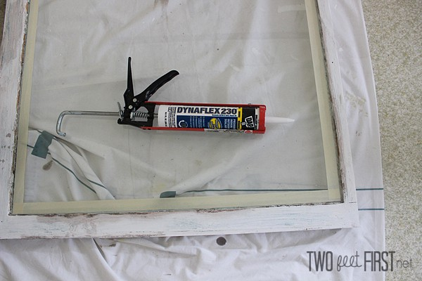 Caulk glass into place
