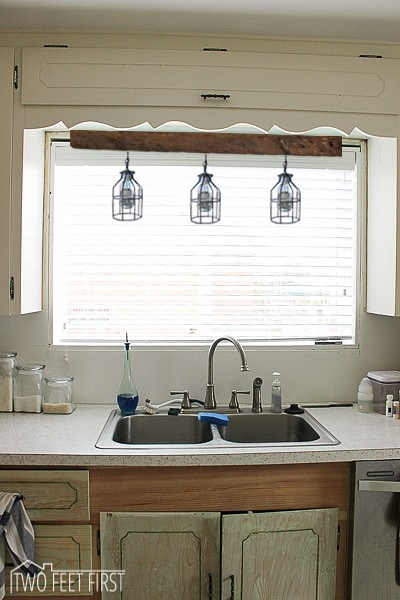 kitchen sink lights lighting above kitchen sink inspiration twofeetfirst 2767