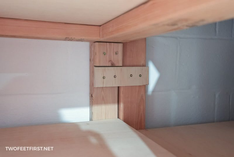 scrap plywood piece attached to storage legs