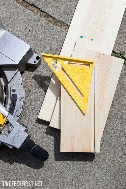 cutting a piece of wood with a miter saw for stool