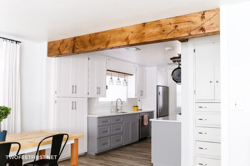 wood beam between kitchen and living room to create open space