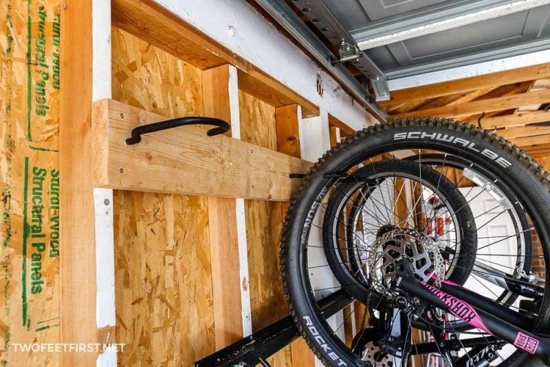bikes hooked onto simple bike rack