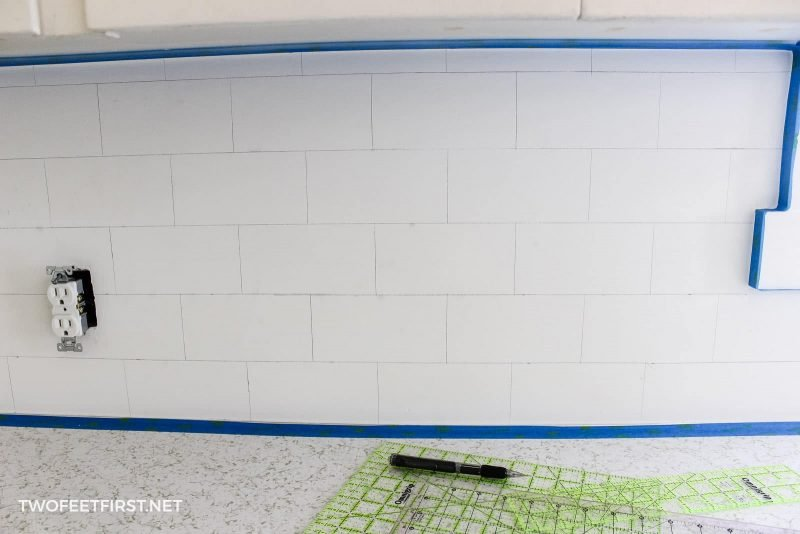 white painted faux subway tile