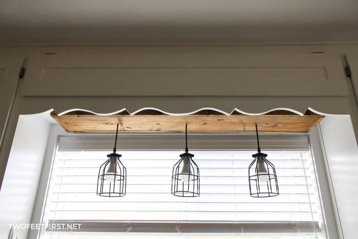 three pendant lights with wood