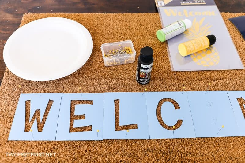 arrange letters for personalized doormat