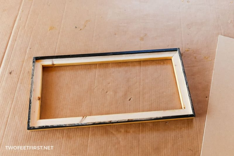 """back of wooden frame with 3/8"""" dowels installed"""