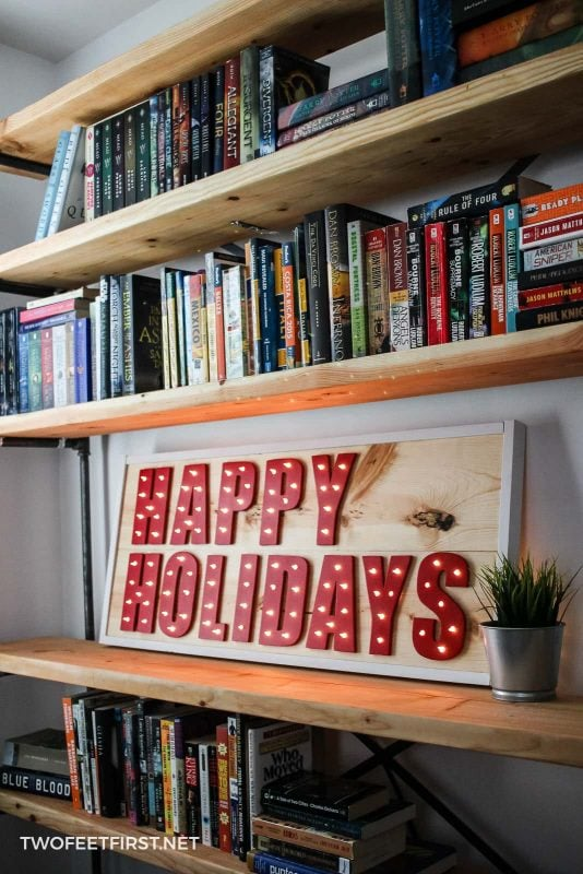 wooden Christmas sign with lights