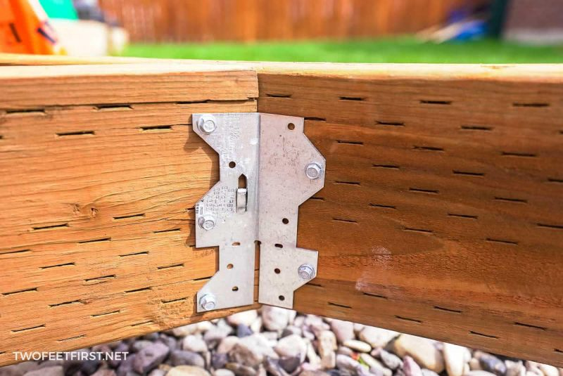 joist hanger for angle of pressure treated lumber