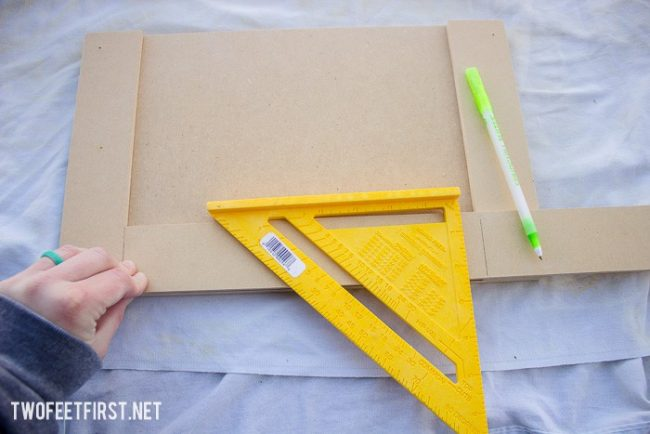 use square to mark trim for cabinet doors