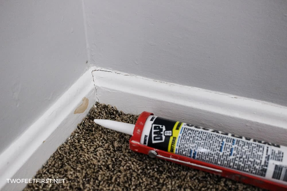 apply caulk to baseboard before painting wall