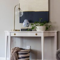 How to Create DIY Art by Painting Over a Thrifted Canvas.