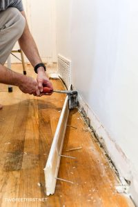 removing baseboard with trim puller