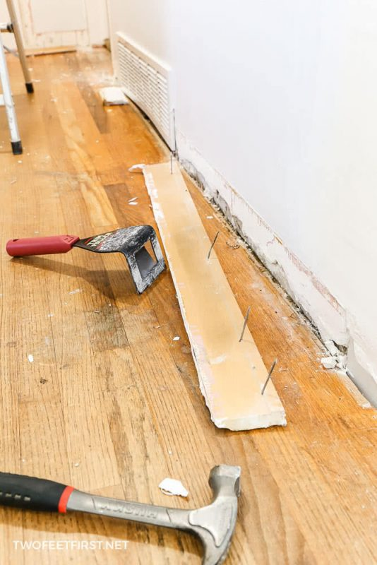trim puller and hammer with baseboard removed