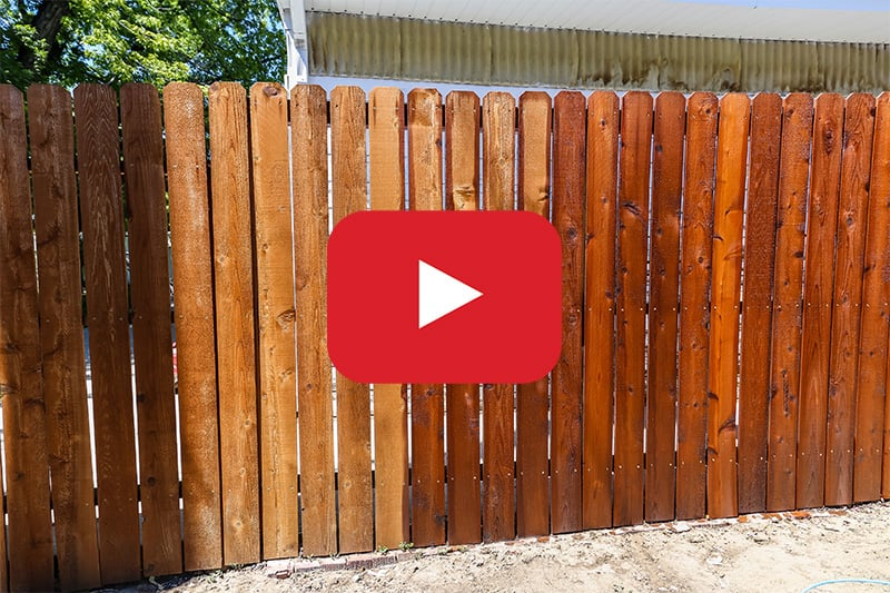 rolling stain on fence with playback button