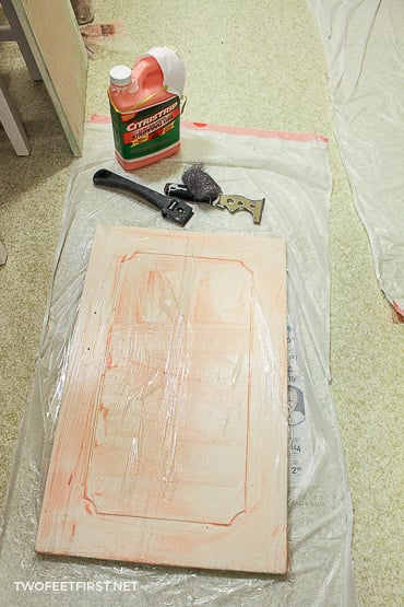 using paint stripper to remove paint from cabinets