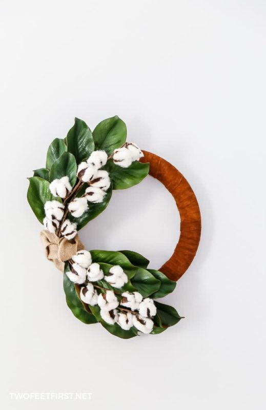 winter wreath with leather, magnolia leaves, cotton, and burlap
