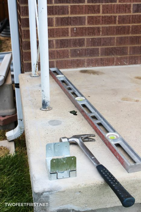 installing metal post base to install post for porch