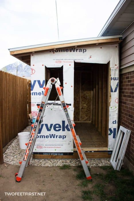 adding house wrap on shed