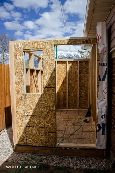 add sheathing to front of shed wall