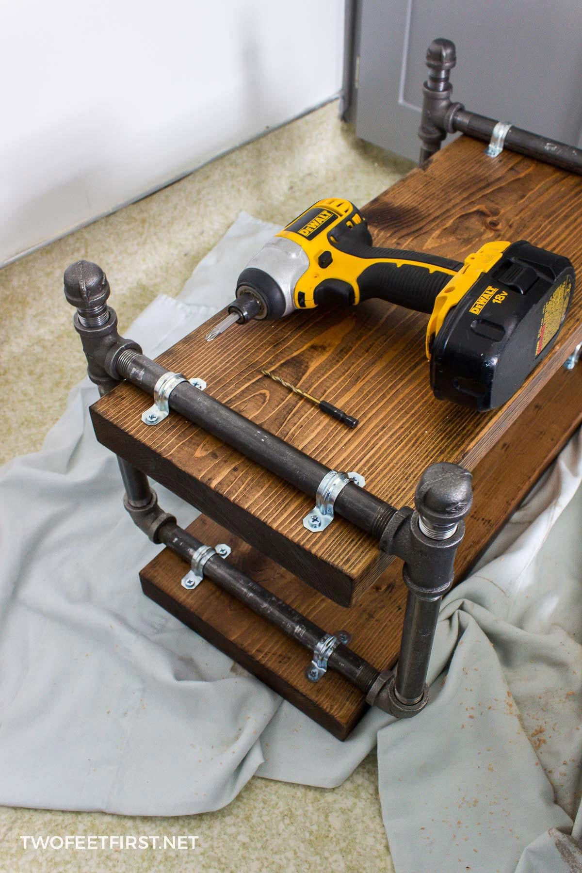 building shoe storage rack with wood and pipe