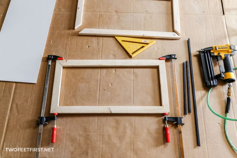 using clamps to clamp a wooden frame together