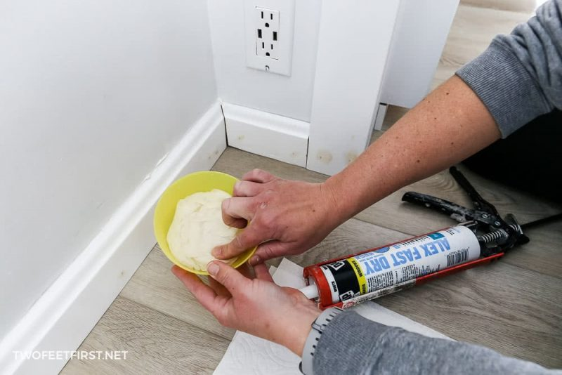 using water to smooth caulk