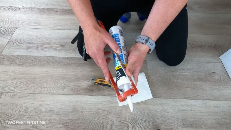 putting caulk tube into caulk gun