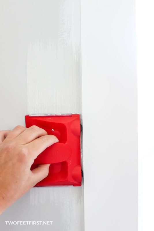 cutting in around wall with paint edger
