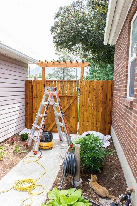 stain a wooden gate natural cedar