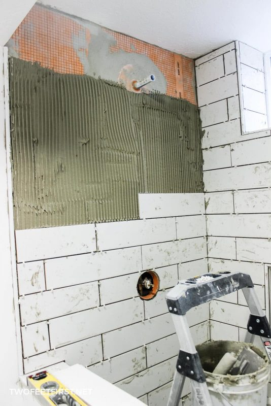installing tile around shower faucet
