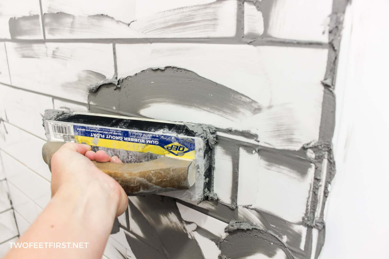 applying grout to tiles