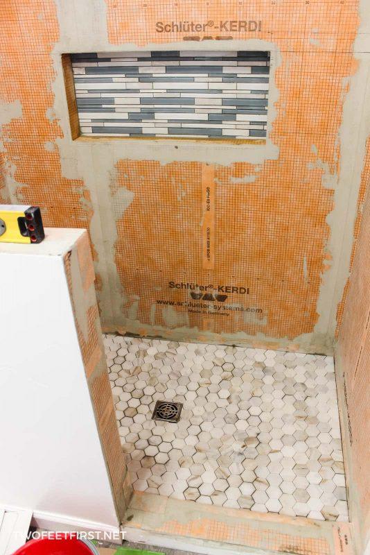 installing tile floor and floor drain in shower
