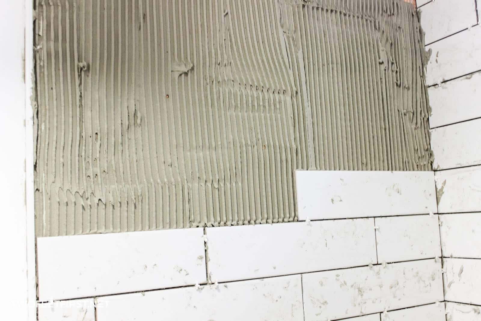 add mortar to wall for tile