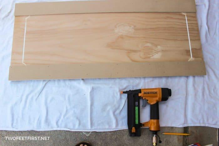 nailing trim to update cabinet door